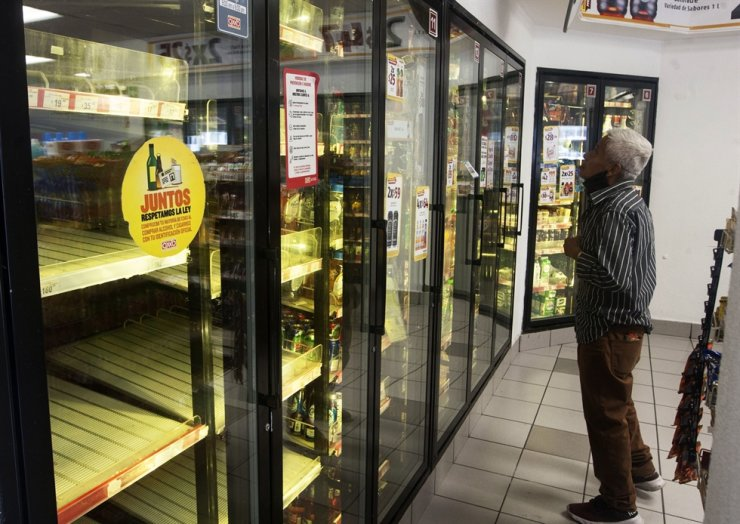 A man looks for a soda drink following the shortage of beer, after the breweries countrywide closed their production due to the COVID-19 coronavirus in Monterrey, state of Nuevo Leon, Mexico, on May 5. /AFP