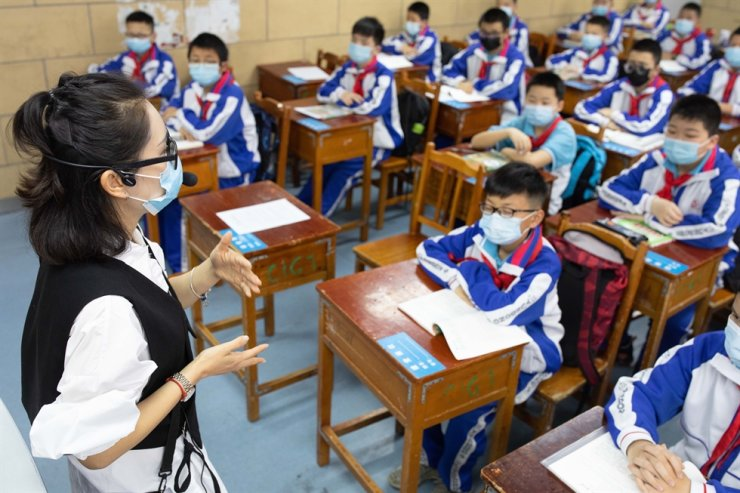 Students wear face masks at school in China this week. / Xinhua/Ou Dongqu