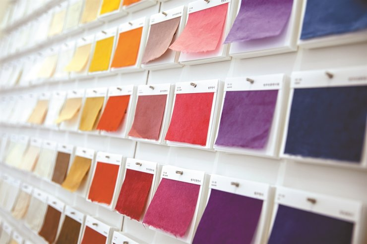 Colorful sample sheets of hanji are currently on display at the Hanji Culture and Industry Center in Seoul, May 20. Various kinds of hanji are categorized by production region, use and type. Korea Times photo by Choi Won-suk