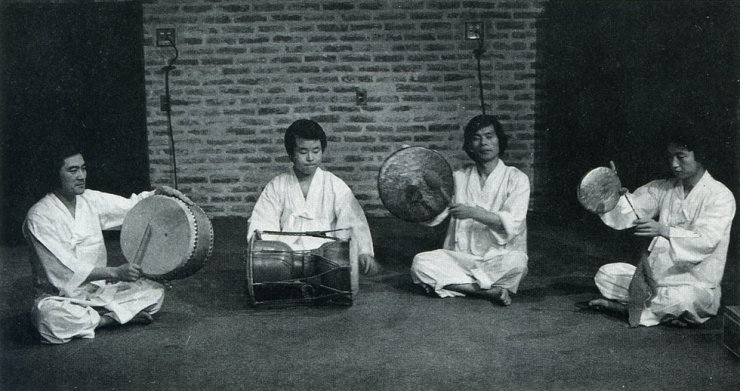 A performance is given by SamulNori, the first samulnori performance group which founded the musical genre in 1978, in this undated photo. From left are Lee Kwang-soo, Kim Duk-soo, Choi Jong-sil and Kim Yong-bae. Courtesy of SamulNori Hanullim