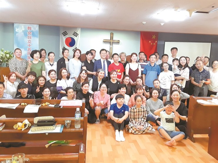 Pastor Choe and his church members gather at Seoul Chinese Church to celebrate its 15th anniversary in this 2018 file photo. / Courtesy of Choe Hwang-kyu