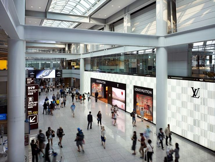 Travelers walk by Louis Vuitton's duty free store at Incheon International Airport in this 2011 file photo. / Yonhap