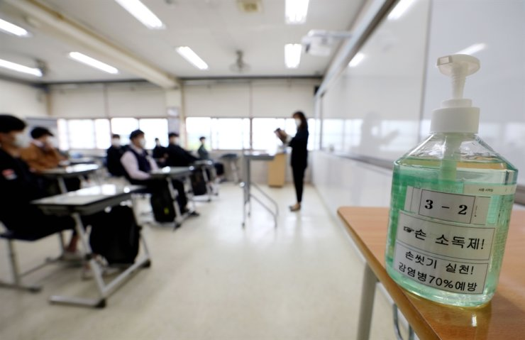 Hand sanitizer is everywhere, from the main gate and playground to classrooms. Korea Times photo by Shim Hyun-chul
