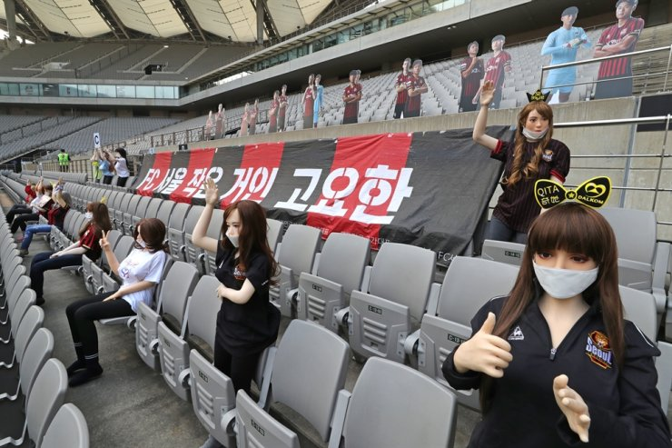 Sex dolls are being displayed during the K League 1 match between FC Seoul and Gwangju FC at the Seoul World Cup Stadium, Sunday. / Yonhap