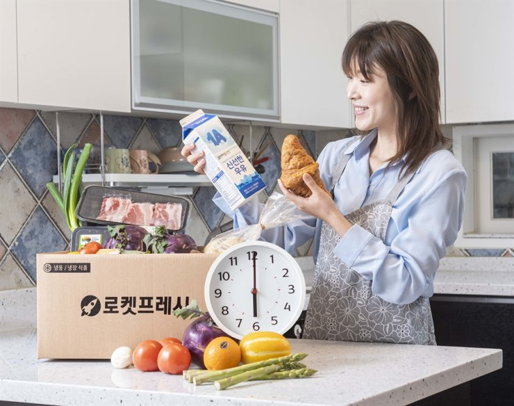 A model promotes Coupang's Rocket Fresh Same-Day Delivery service in this undated file photo. Courtesy of Coupang
