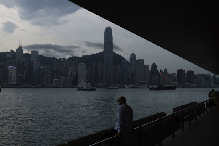 A man sits on the waterfront of the Victoria Harbor of Hong Kong Tuesday, May 26, 2020. AP