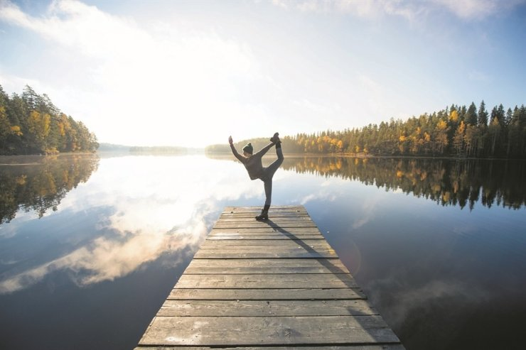 A person does yoga at Repovesi National Park of Finland. Visit Finland has launched the 'Rent a Finn goes Virtual' campaign to showcase the Finns' natural way of life. / Courtesy of Visit Finland