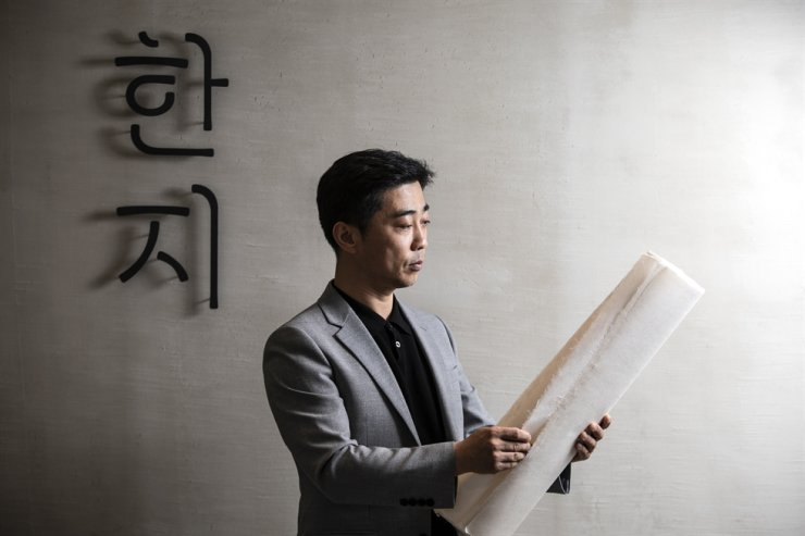 Kim Chun-ho, a fifth-generation hanji maker, poses for a photo after an interview with The Korea Times at the Hanji Culture and Industry Center in Seoul, May 20. / Korea Times photo by Choi Won-suk