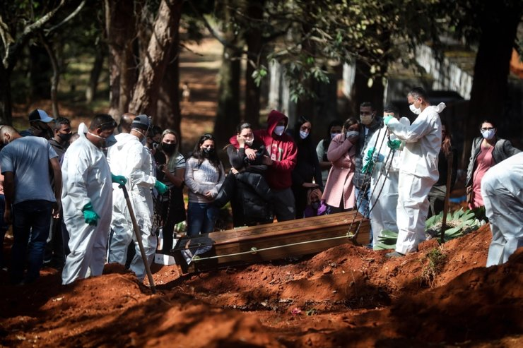 Workers bury a suspected victim of COVID-19 at the Vila Formosa cemetery in Sao Paulo, Brazil, May 18, 2020. EPA