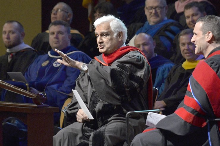 In this March 30, 2016, photo, Christian apologist and author Ravi Zacharias talks with Associate Professor Lenny Luchetti during the Society of World Changers induction ceremony at Indiana Wesleyan University in Marion, Ind. Zacharias, who built an international ministry that strives to defend Christianity on intellectual grounds, has died at his home in Atlanta. AP