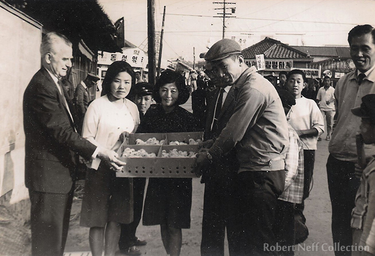 Members of the Kanaan Poultry Corporation. Chang Don-sik, the president, is in the center and next to him is Fred Dustin. Circa 1963