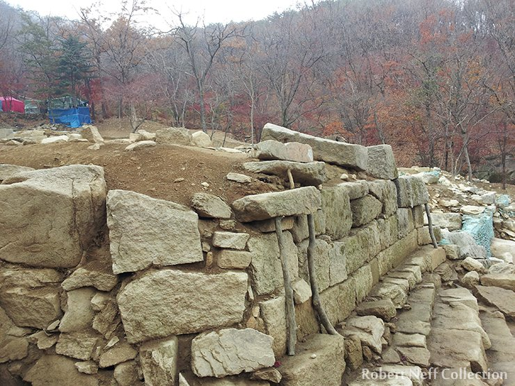 Excavated walls being supported by large sticks. November 2014. Robert Neff Collection