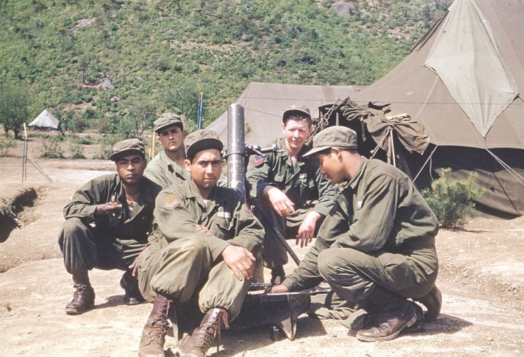 Colombian infantry pose in front of their barracks.