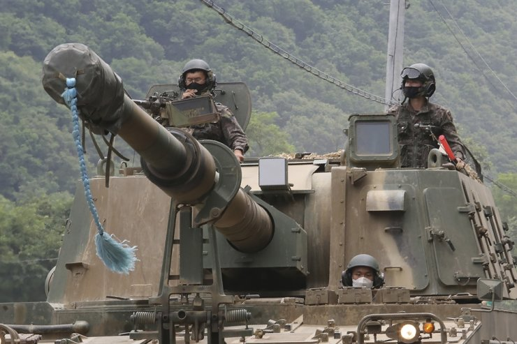 South Korean army soldiers ride a K-9 self-propelled howitzer during the annual exercise in Paju, South Korea, near the border with North Korea, Tuesday, June 23, 2020. AP