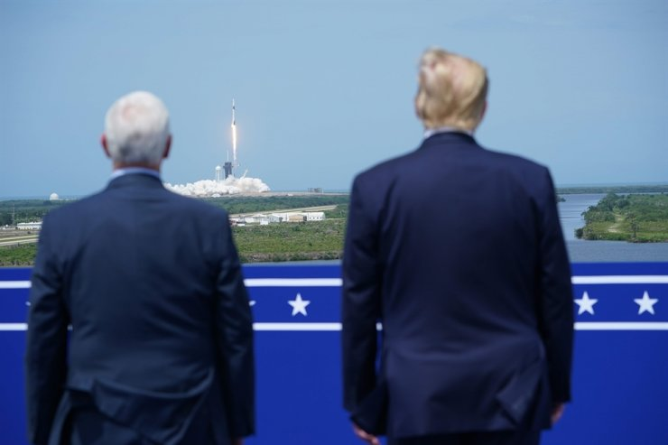 U.S. Vice President Mike Pence and the President Donald Trump watch the SpaceX Falcon 9 rocket carrying the SpaceX Crew Dragon capsule, with astronauts Bob Behnken and Doug Hurley, lifts off from Kennedy Space Center in Cape Canaveral, Fla., Saturday. /AFP