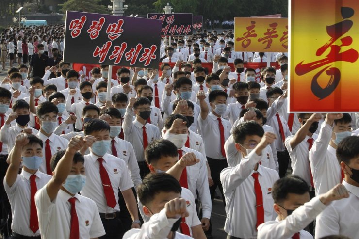 North Korean youth and students march from the Pyongyang Youth Park Open-air Theatre to Kim Il Sung Square during a protest demonstration to denounce South Korean authorities' policy against North Korea and defectors from the north, in Pyongyang, North Korea Monday, June 8, 2020. The signs read 'Give us an order (to punish South Korea).' AP