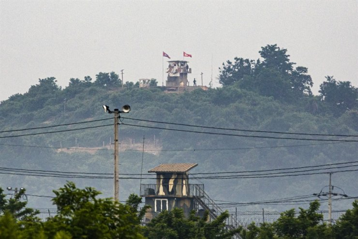 North Korean soldiers standing guard are seen from the unification observatory in Paju, South Korea, near the border with North Korea, Wednesday. After destroying an inter-Korean liaison office at the Gaeseong Industrial Complex Tuesday, North Korea's military said Wednesday that it will reinstall guard posts and resume military exercises at front-line areas, nullifying the tension-reducing deals reached with South Korea two years ago. Korea Times photo by Shim Hyun-chul