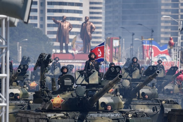 In this file photo taken on Sept. 9, 2018, Korean People's Army tanks take part in a military parade on Kim Il Sung square in Pyongyang. North Korea's army is 'fully ready' to take action against the South, state media said on June 16, 2020, in the latest verbal sabre-rattling from Pyongyang, days after its leader's sister threatened military moves against Seoul. AFP