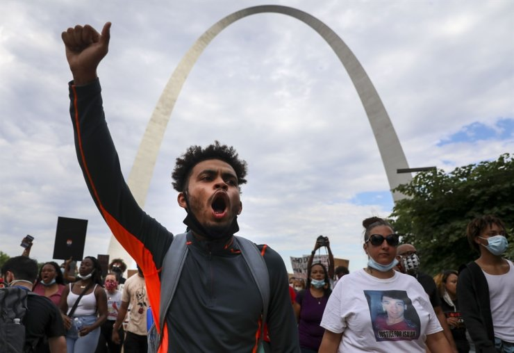 Johnnie Williams chants with the crowd during a protest in St. Louis on Monday. St. Louis Post-Dispatch via AP