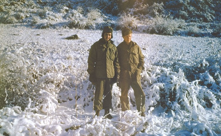 Two Colombian soldiers deployed to the Korean War stand outside in winter 1952.