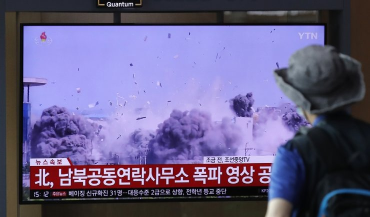 A man watches a TV screen showing a news program with a video of the demolition of the inter-Korean liaison office building in Kaesong, North Korea, at the Seoul Railway Station in Seoul, South Korea, Wednesday, June 17, 2020. AP