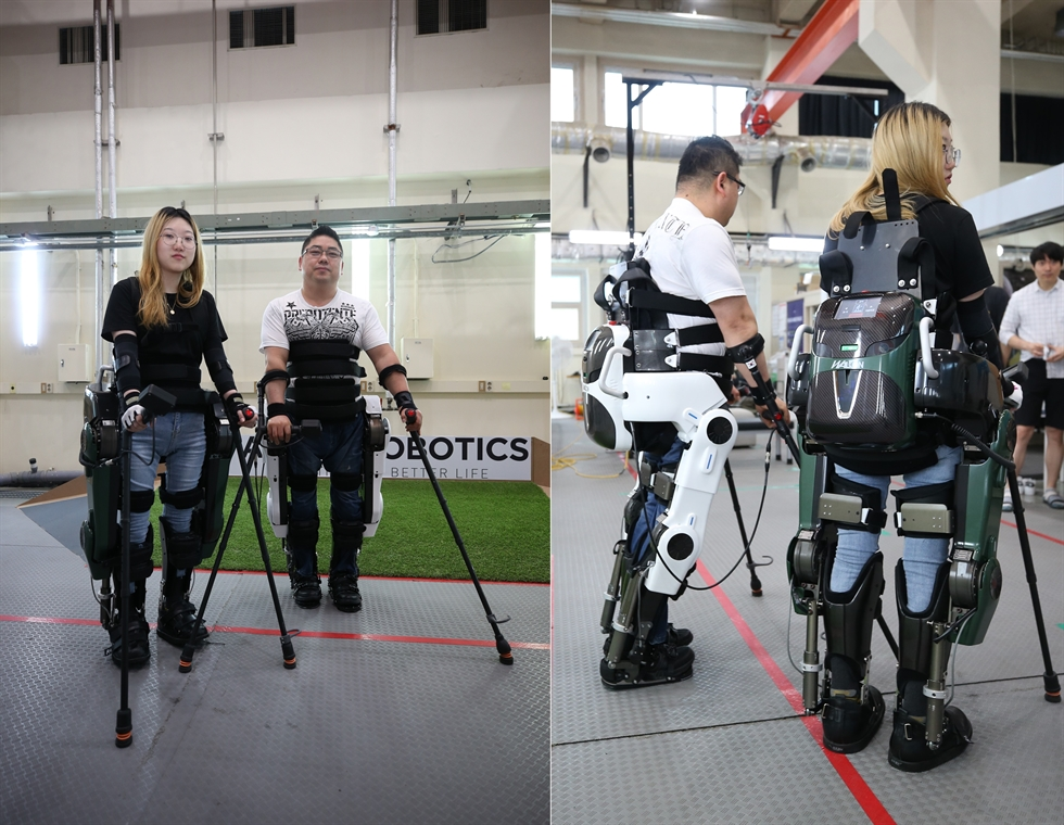 A wearable robot for patients paralyzed from the waist down was revealed Monday. The Korea Advanced Institute of Science and Technology (KAIST), a top national research university in Daejeon, said the robot is designed to help people walk, climb stairs and open doors among many other daily tasks. Courtesy of KAIST