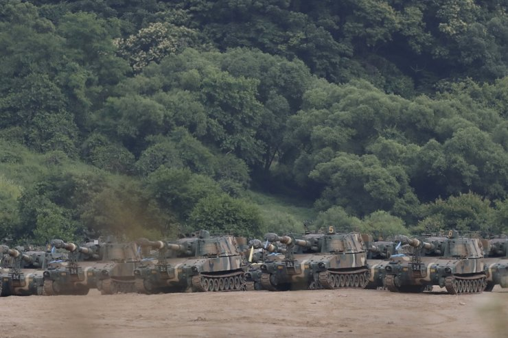 South Korean Army's K-55 self-propelled howitzers are seen at the border with North Korea, South Korea, Tuesday, June 16, 2020. AP