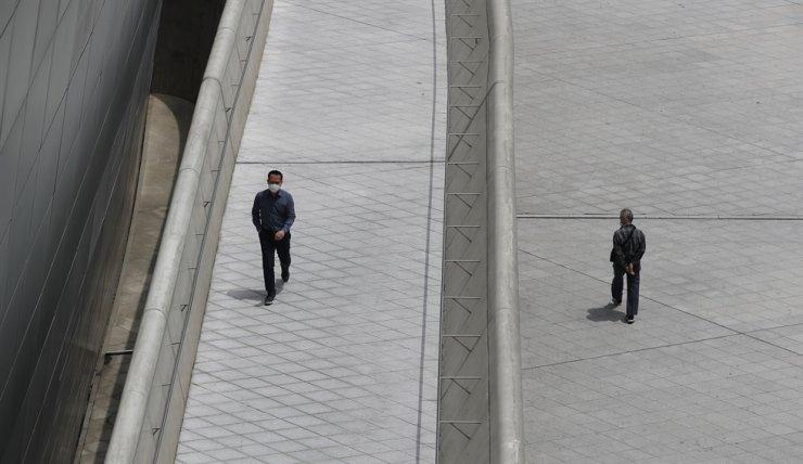 Visitors wearing face masks walk at the Dongdaemun Design Plaza in Seoul, Wednesday, June 3, 2020. AP