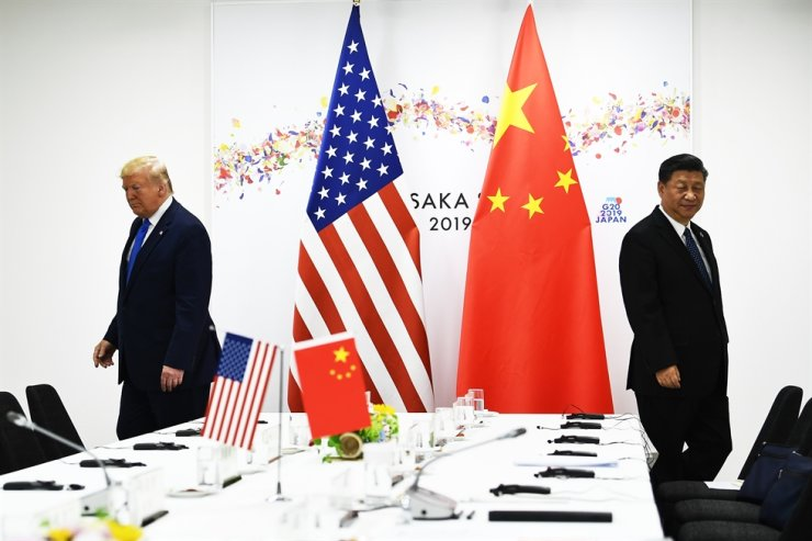 Chinese President Xi Jinping (R) and US President Donald Trump attend their bilateral meeting on the sidelines of the G20 Summit in Osaka on June 29, 2019. /AFP