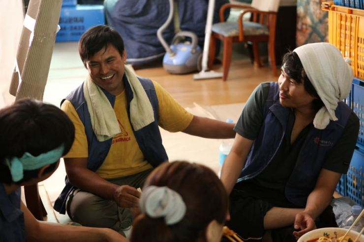 A Filipino migrant worker Alvin, second from left, in a scene from