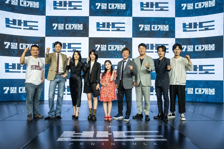 Director Yeon Sang-ho, left, and the cast of 'Peninsula' pose for a photo at the online press conference for the film in Seoul, Tuesday. / Courtesy of NEW