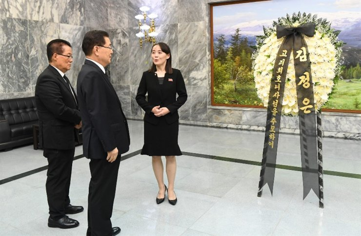 Park Jie-won, left, the nominee for national Intelligence Service (NIS) chief, receives condolences from the North Korean leader's sister Kim Yo-jong, right, on behalf of her brother upon the death of former first lady Lee Hee-ho on June 12, 2019, at Panmunjeom. Park is accompanied by Chung Eui-yong, then-national security adviser. Park's ties long ties with North Korea's Kim dynasty is one of the primary factors in Moon's surprise decision to name him as the NIS chief. Yonhap