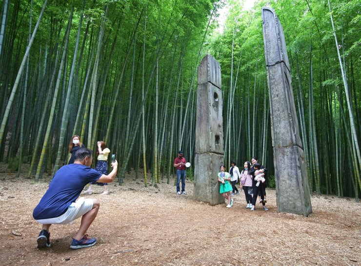 A man takes a picture of his family in Ahopsan Forest in Busan. / Courtesy of Korea Tourism Organization