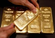 An employee shows gold bullions at Degussa shop in Singapore, in this June 16, 2017 photo. Reuters