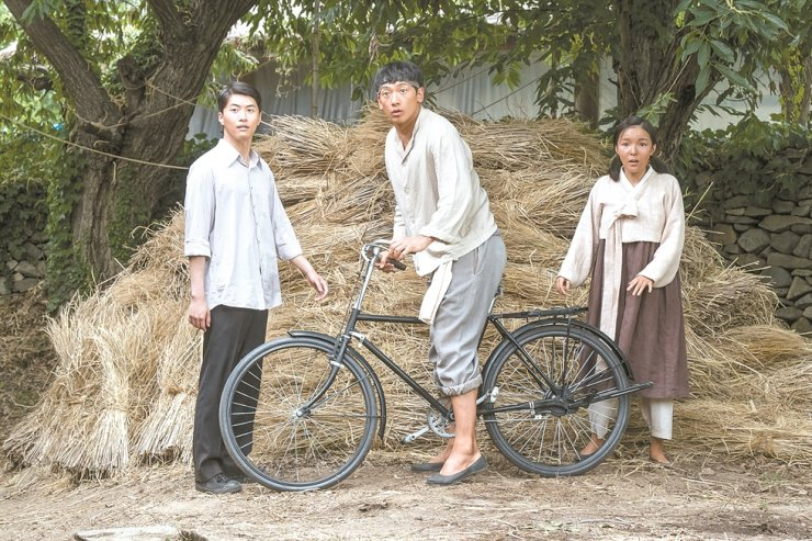 Singer-actor Jung Ji-hun, center, better known ashis stage name Rain, in a scene from the 2019 film