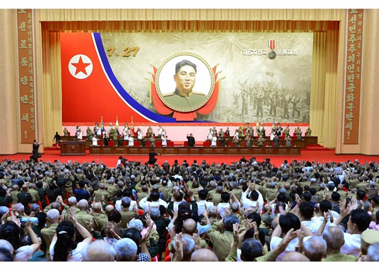 Participants of the 67th anniversary ceremony of the end of the Korean War held at Pyongyang's April 25 House of Culture fervently respond to a greeting from the North Korean leader Kim Jong-un who is at the center of the stage. KCNA-Yonhap