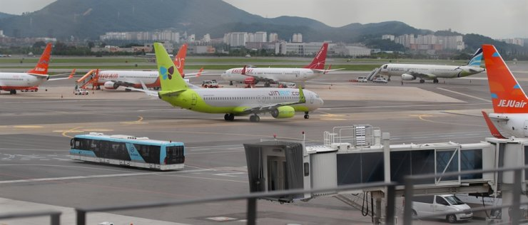 Passenger jets from the nation's low cost carriers are at Gimpo International Airport in Seoul, on July 28. Concerns are growing over mass layoffs of LCC employees amid longer-than-expected virus shocks. Yonhap
