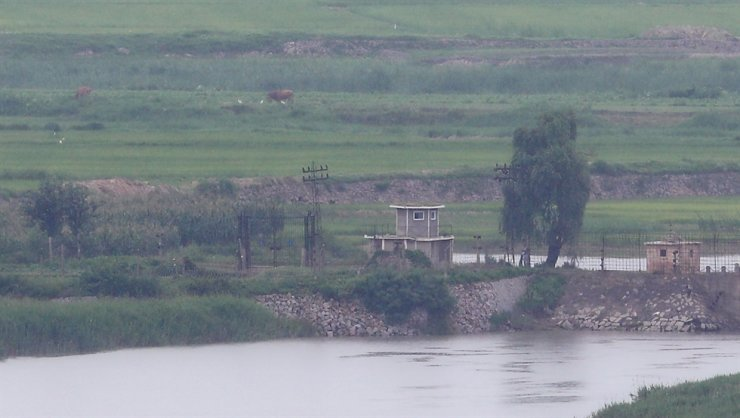 This photo shows fields in North Korea's Kaepung County on the western front-line border with South Korea, Monday, seen from Ganghwa Island in the South. Yonhap
