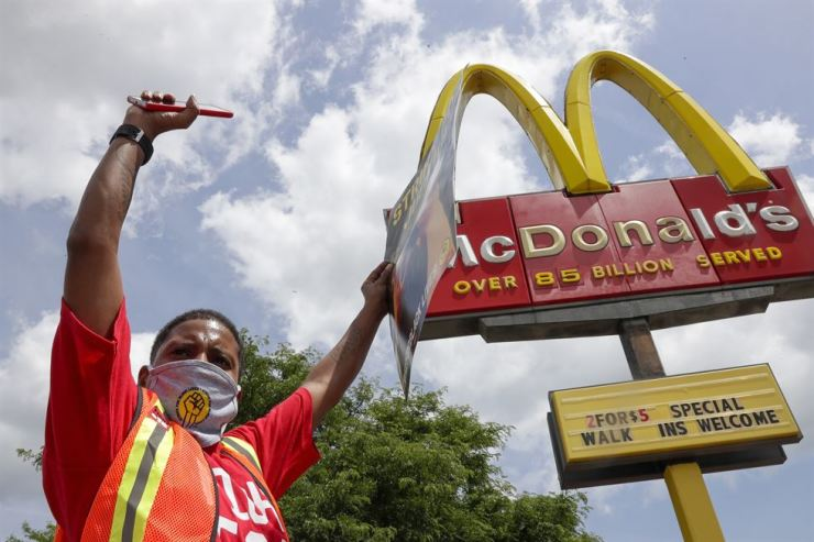 Strike for justice protesters are seen outside a McDonald's Monday, July 20, 2020, in Milwaukee. AP-Yonhap