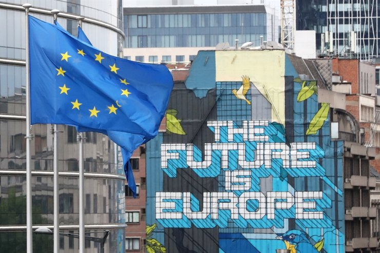 European Union flags flutter outside the European Commission headquarters, ahead of an EU leaders summit at the European Council headquarters, in Brussels, Belgium, July 16. / Reuters-Yonhap
