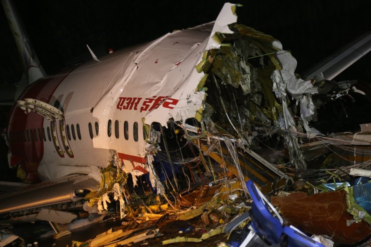 A view of the wreckage of the of an Air India Express Boeing 737 after it crashed at Calicut International Airport in Kozhikode, India, Aug. 8, 2020. EPA