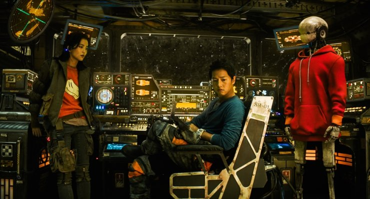 Song Joong-ki, center, and Kim Tae-ri, left, in 'Space Sweepers' / Courtesy of Merry Christmas