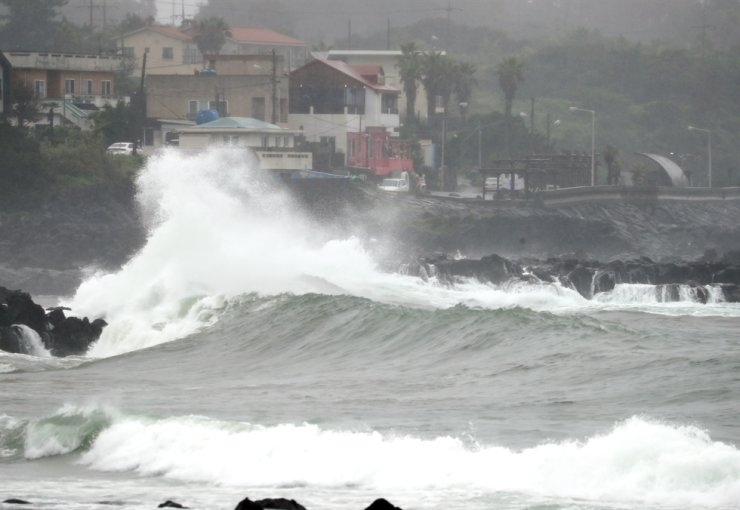 Surging waves smash against the breakwater at a port on Jeju Island, Monday. Yonhap