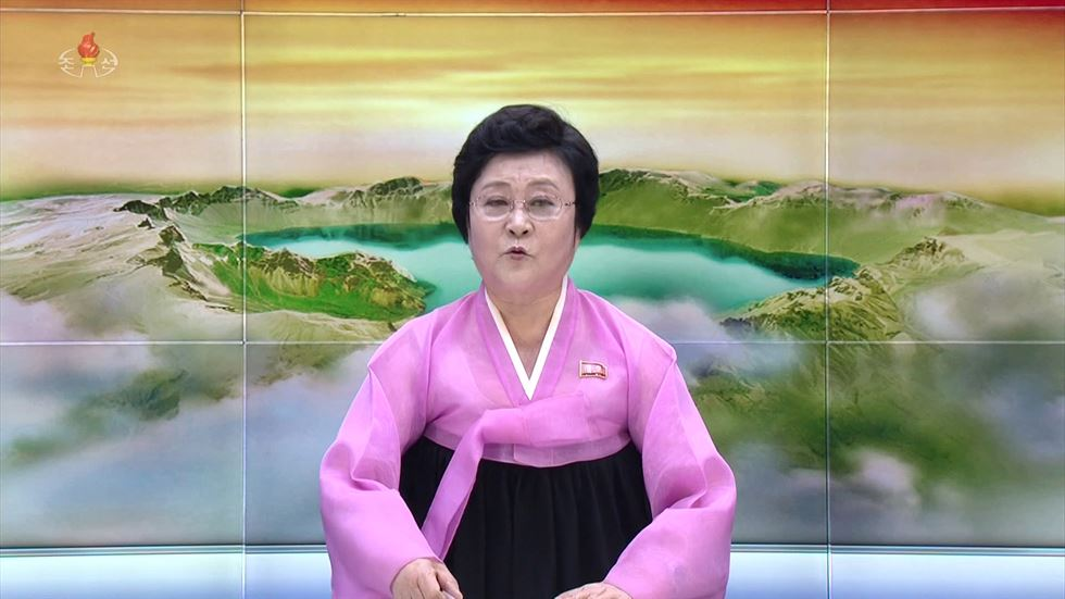 A female anchor of North Korea's YouTube channel 'Echo of Truth' enjoys fried chicken and beer in a video posted Aug. 1. / Captured from Echo of Truth