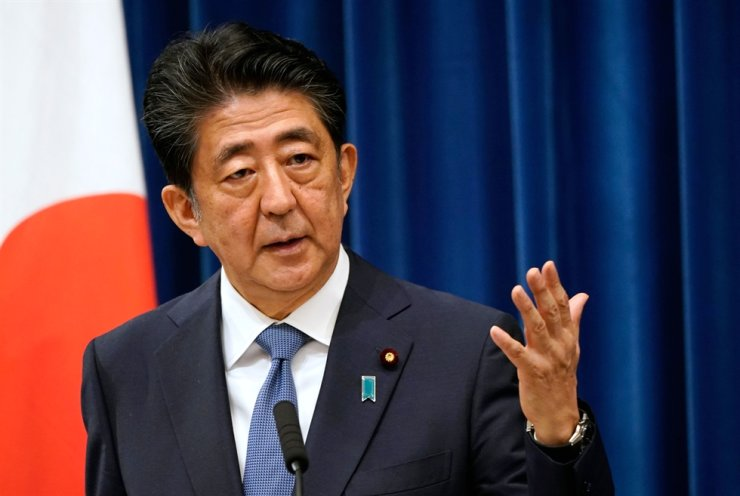 Japanese Prime Minister Shinzo Abe speaks during his press conference at the prime minister official residence in Tokyo, Friday. / AFP-Yonhap