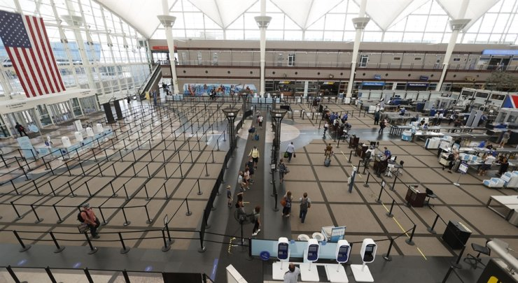 Travelers make their ways to the south security checkpoint in the main terminal of Denver International Airport in Denver, in this July 22, 2020 photo. AP