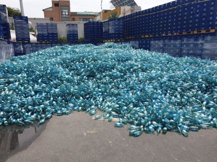 In this October 2019 photo, Jinro Is Back bottles are piled up at Lotte Chilsung Beverage's Cheongju brewery in North Chungcheong Province. Courtesy of Rep. Sul Hoon