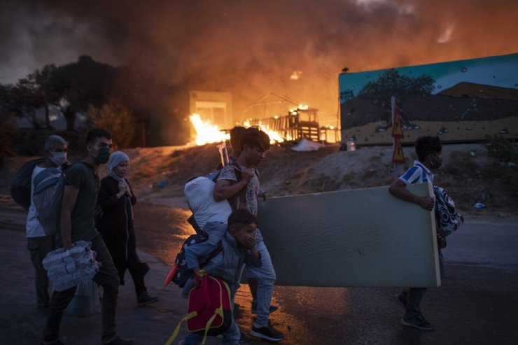 Migrants flee from the Moria refugee camp during a second fire, on the northeastern Aegean island of Lesbos, Greece, on Wednesday, Sept. 9, 2020. /AP