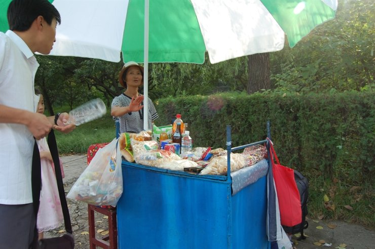 A vendor in Moranbong Park, Pyongyang, refuses to sell to foreigners, August 2010. / Korea Times photo by Jon Dunbar