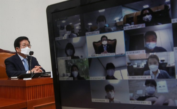 National Assembly Speaker Park Byeong-seug answers reporters during an online press conference to mark his 100th day in office, at the National Assembly in Seoul, Wednesday. Park suggested holding the presidential election and local elections, scheduled for March and June 2022, respectively, at the same time to save resources. Yonhap